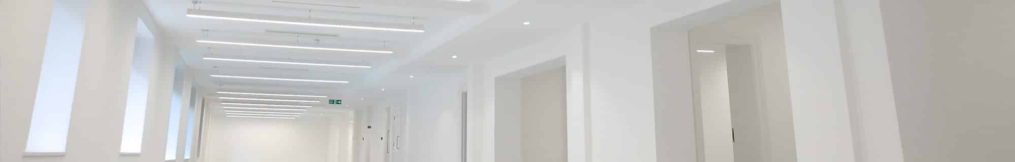 Mount lighting luminaires installed in hallway
