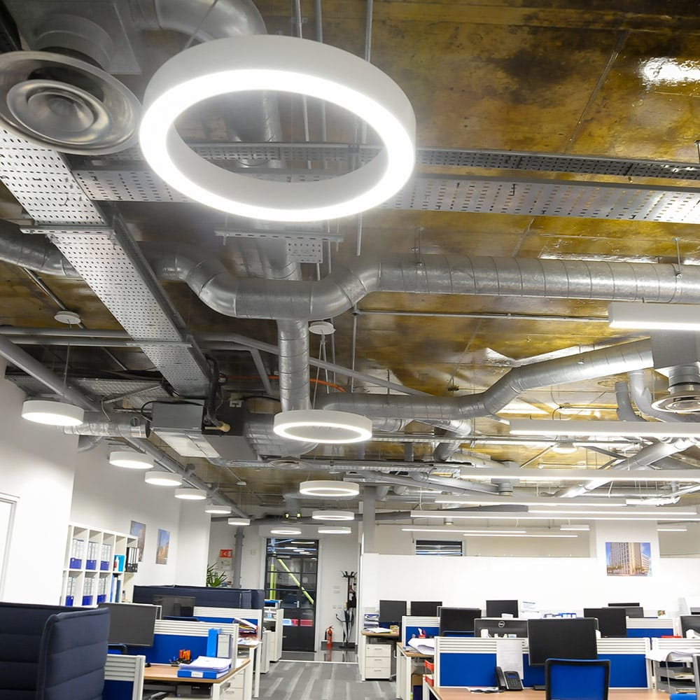 Suspended lighting installed on ceiling in London project.