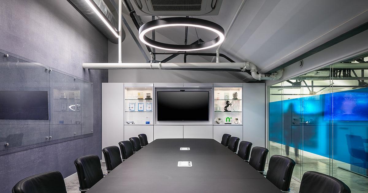 Pendant lighting in an office boardroom.